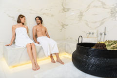 Couple enjoying hot sauna Royalty Free Stock Images
