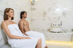 Couple enjoying hot sauna royalty free stock photos