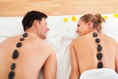 Couple enjoying a hot stone massage