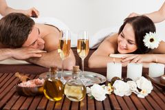 Couple enjoying hot stone massage at spa Royalty Free Stock Photos