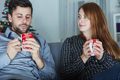 Couple enjoying hot tee or coffee Royalty Free Stock Image