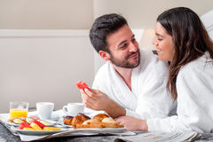 Couple enjoying hotel room service. Royalty Free Stock Images