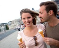 Couple enjoying an ice cream Stock Images