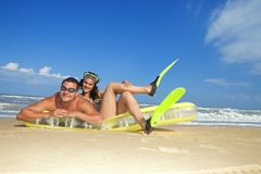 Couple enjoying on an inflatable beach mattress Royalty Free Stock Photography