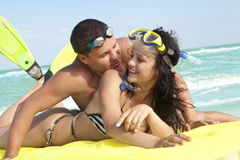 Couple enjoying on an inflatable beach mattress Royalty Free Stock Photos