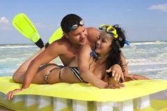 Couple enjoying on an inflatable mattress Royalty Free Stock Photography