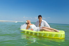Couple enjoying on an inflatable mattress Royalty Free Stock Photo