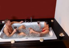 Couple enjoying jacuzzi Stock Photos