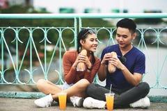 Free Couple Enjoying Juice And Sanwiches Stock Photos - 120528553
