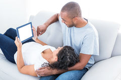 Couple enjoying with laptop Royalty Free Stock Images