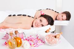 Couple Enjoying A Lastone Massage Royalty Free Stock Photography