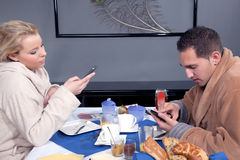 Couple enjoying a leisurely breakfast Royalty Free Stock Image