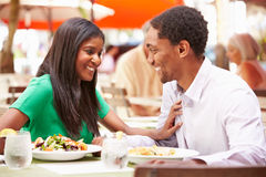 Couple Enjoying Lunch In Outdoor Restaurant Stock Images