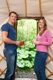 Couple Enjoying Luxury Camping Holiday In Yurt Stock Photography