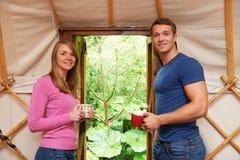 Couple Enjoying Luxury Camping Holiday In Yurt Royalty Free Stock Images