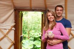 Couple Enjoying Luxury Camping Holiday In Yurt Stock Photo