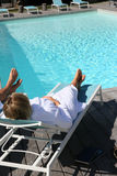 Couple enjoying luxury resort by the swimming pool Royalty Free Stock Image