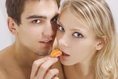 Couple enjoying mandarin Royalty Free Stock Image
