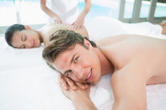 Couple enjoying massage at health farm Stock Photos