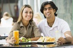 Couple enjoying meal at cafe. Couple enjoying mea sitting at cafe table stock image