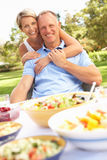 Couple Enjoying Meal In Garden Stock Images