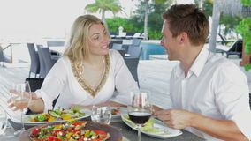 Couple Enjoying Meal In Outdoor Restaurant. Shot on Canon 5d Mk2 with a frame rate of 30fps stock footage