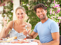 Couple Enjoying Meal outdoorss Stock Photos