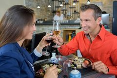 Couple enjoying meal together Royalty Free Stock Photo