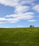Couple enjoying the morning at the park. Illustration of couple sitting on a grassy hill Royalty Free Stock Photography
