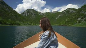 Couple enjoying a motor boat ride on the lake. On a sunny day stock video footage