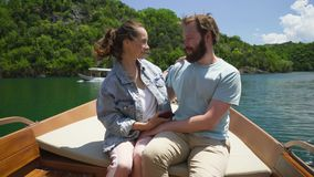 Couple enjoying a motor boat ride on the lake. On a sunny day stock video