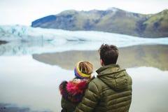Couple Enjoying Mountains and Lake stock images