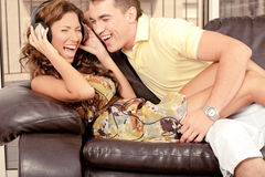 Couple enjoying music Royalty Free Stock Photography