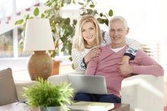 Couple enjoying new technology Stock Photography