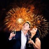 Couple Enjoying New Year`s Eve Stock Images