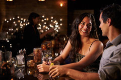 Couple Enjoying Night Out At Cocktail Bar Royalty Free Stock Photos