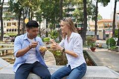 Couple enjoying noodles royalty free stock image