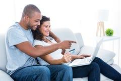 Couple enjoying online shopping Stock Photo