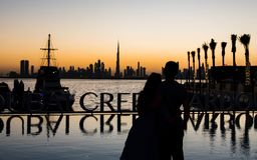 Couple enjoying panoramic view of Dubai. At sunset royalty free stock photos