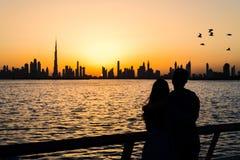 Couple enjoying panoramic view of Dubai. At sunset stock images
