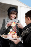 Couple Enjoying Pastry Outdoors Stock Images