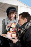 Couple Enjoying Pastry Outdoors Royalty Free Stock Images