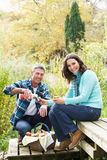 Couple Enjoying Picnic In Autumn stock photos