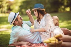 Couple enjoying picnic time outdoor. Beautiful couple enjoying picnic time outdoor stock photos