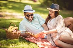 Couple Enjoying Picnic Time Outdoor Reading Book Royalty Free Stock Photo