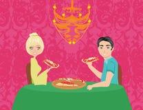 Couple enjoying pizza Royalty Free Stock Image