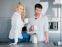 Couple enjoying a pot of freshly brewed coffee Stock Photography