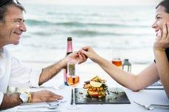 Couple enjoying a private beach dinner stock photos