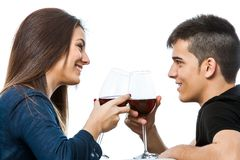 Couple enjoying red wine together. Stock Image