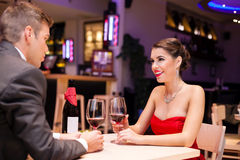 Couple enjoying in a restaurant Royalty Free Stock Photography